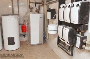 Система отопления на инверторном (изменяемая мощность), геотермальном тепловом насосе NIBE F1155 16 кВт, c коэффициентом COP – 5,12 ( при 0/35 °С), с максимальной температурой подачи 65 °С от компрессора
